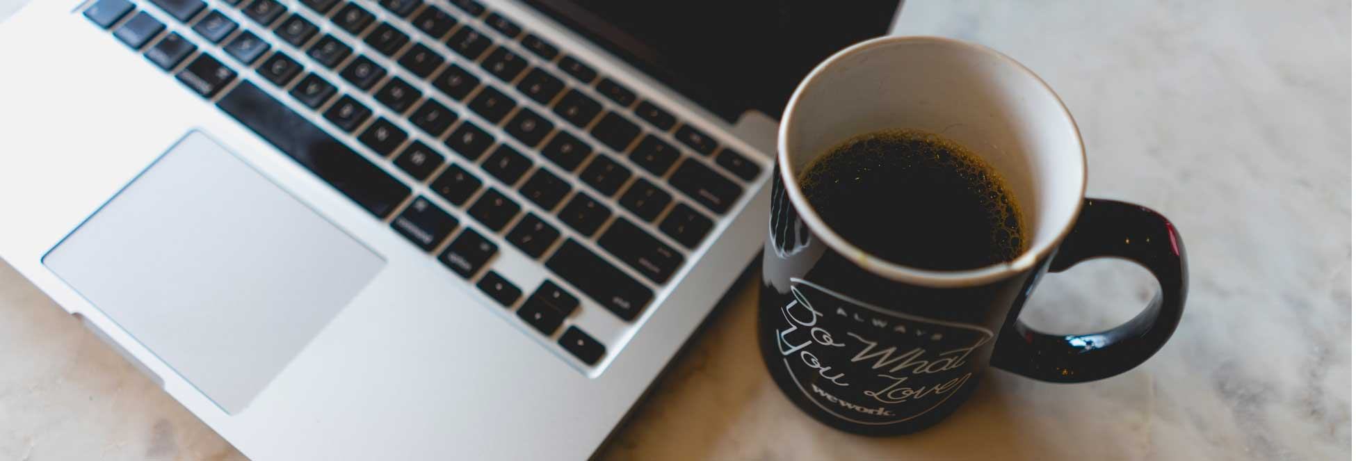 Image of laptop and coffee